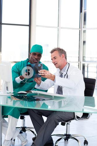 Doctor and surgeon studying an Xray