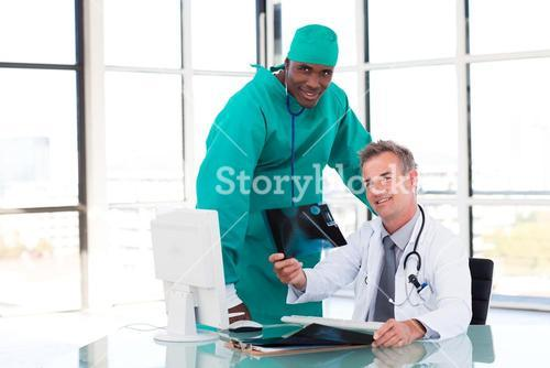 Doctor and surgeon looking at an Xray