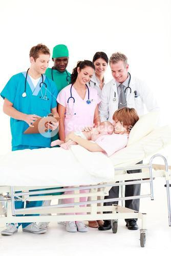 Doctors attending to a mother and her newborn baby