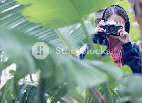 Young brunette taking a picture