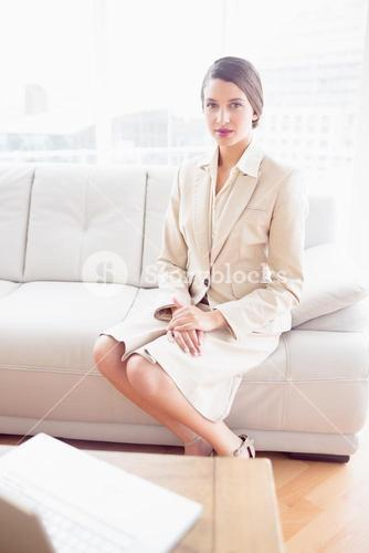 Young businesswoman sitting on sofa