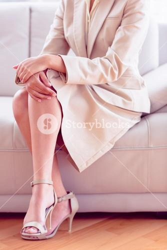 Stylish businesswoman sitting on sofa