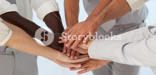 Close up of Business Teams with hands together