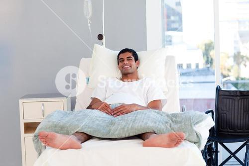 Patient in bed smiling at the camera