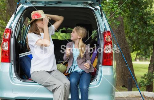 Mother and daughter in car trunk
