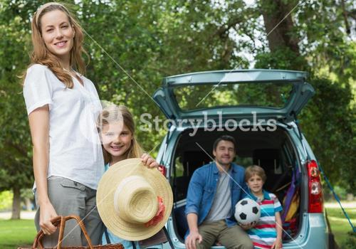 Family with two kids at picnic