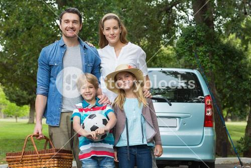 Happy family with car at picnic