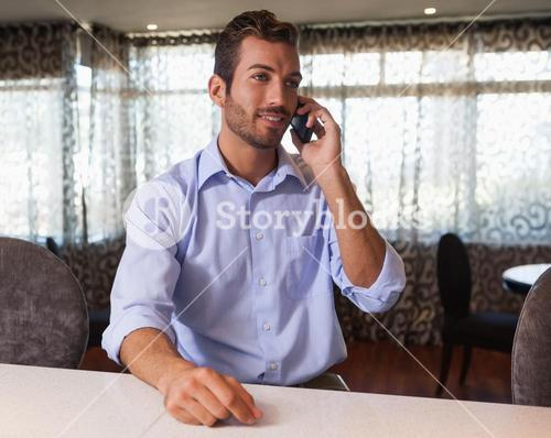 Happy businessman on the phone after work