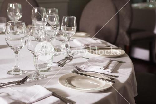 Set table with white linen