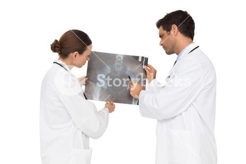 Medical team analysing an xray together