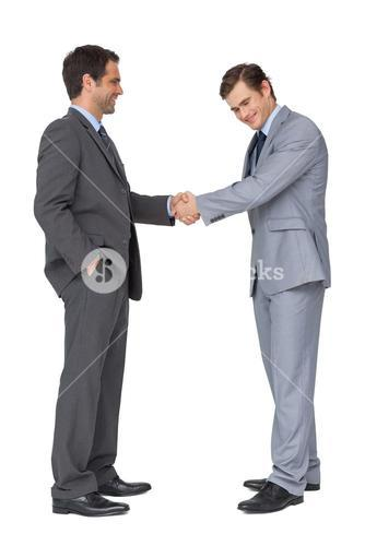 Happy business team shaking hands