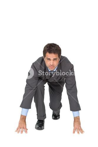Focused businessman ready to race
