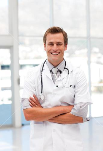 Joyful male doctor looking at the camera