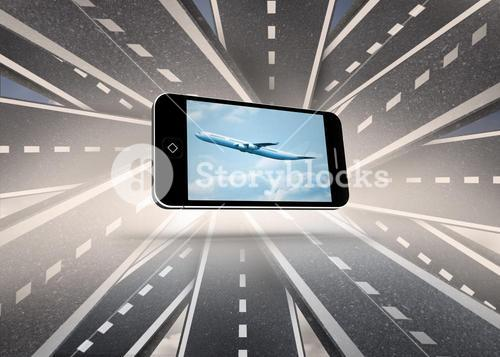 Composite image of airplane on smartphone screen