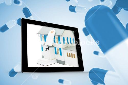 Composite image of house with price tag on tablet screen