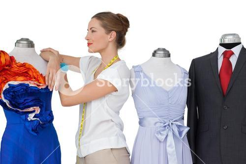 Female fashion designer and mannequins