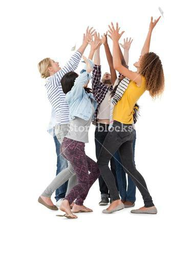 Casually dressed happy young people raising hands