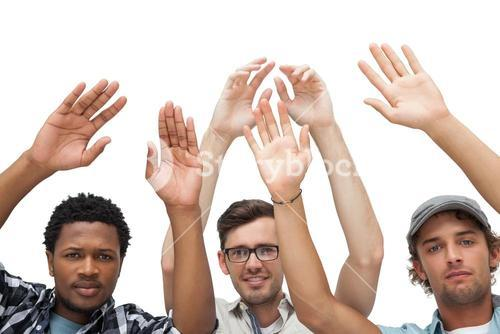 Portrait of three young men raising hands