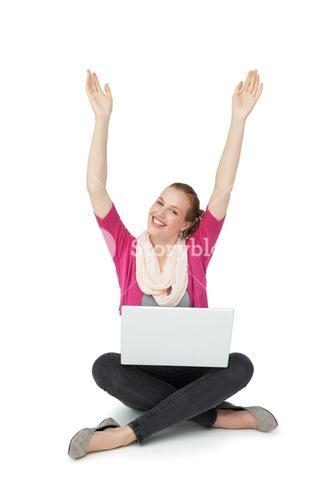 Hppy young woman with laptop raising hands