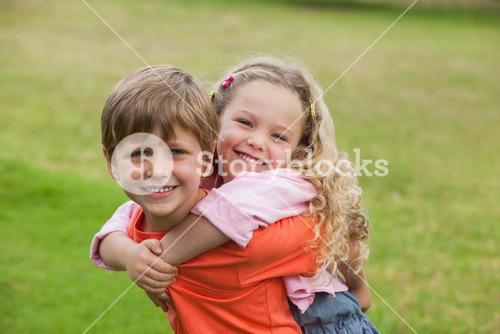 Two happy young kids playing at park