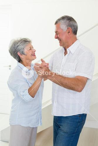Happy senior couple dancing together