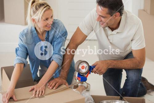 Portrait of a smiling couple packing boxes