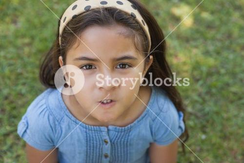 Portrait of a girl making faces at park