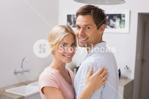 Smiling young couple embracing