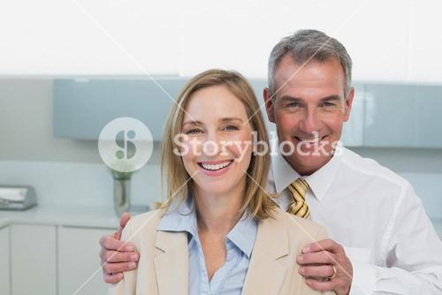 Portrait of a happy business couple in kitchen
