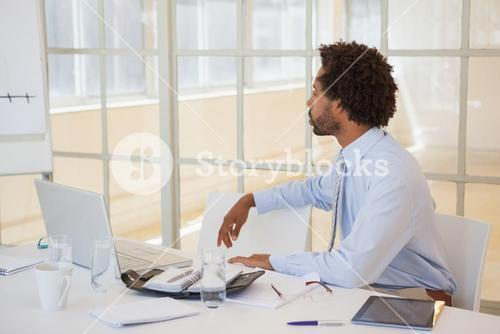 Serious businessman sitting at office desk