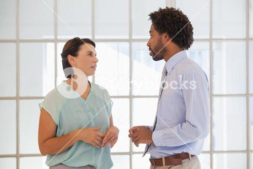 Business people having a conversation in office