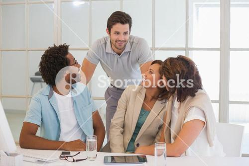 Business people having a conversation at office desk
