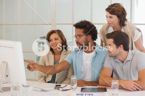 Business people using computer together