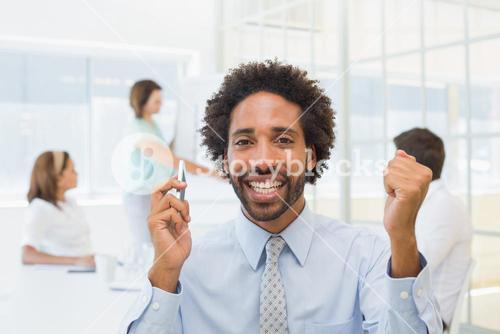 Businessman with colleagues in meeting at office