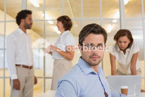 Serious businessman with colleagues in meeting