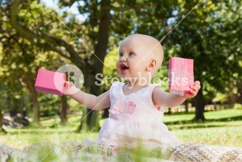 Cute baby with box at the park