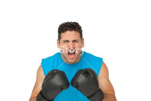 Close-up portrait of a determined male boxer screaming