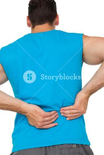 Rear view of man in sportswear suffering from backache