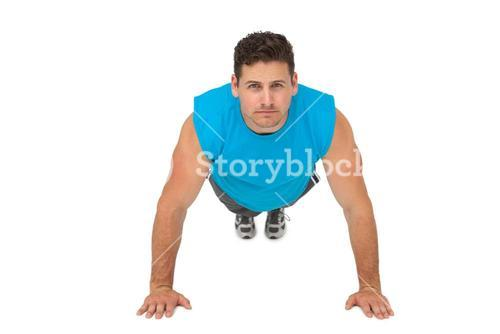 Portrait of a determined man doing push ups