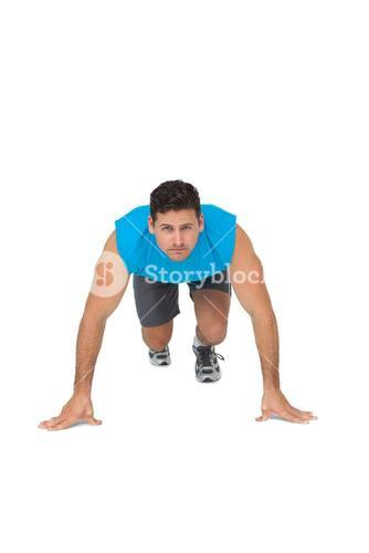 Portrait of a determined young man doing push ups
