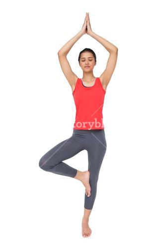 Full length of a fit woman standing in tree pose