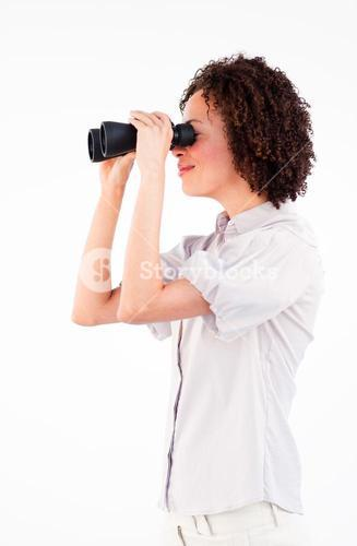 Sideways portrait of businesswoman with binoculars
