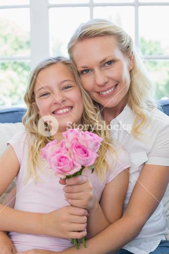Mother and daughter with rose bouquet
