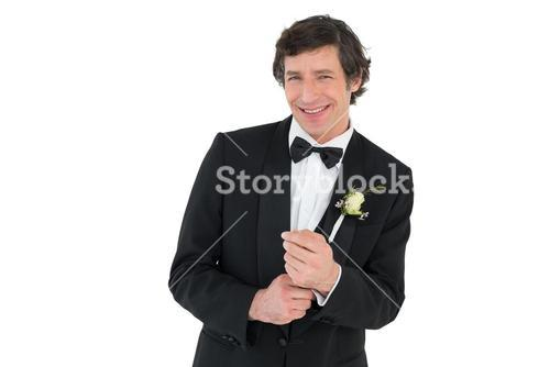 Man adjusting cuff links before wedding