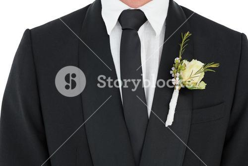 Groom wearing tuxedo with corsage