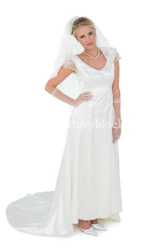 Confident bride with hand on waist