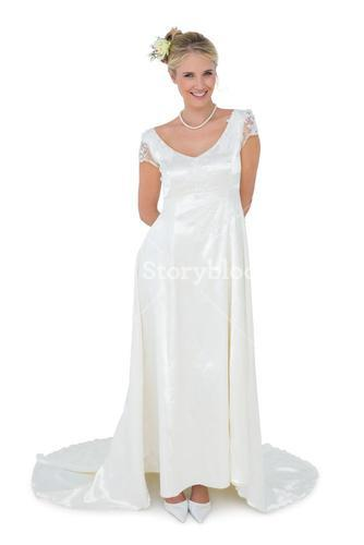 Happy bride standing over white background