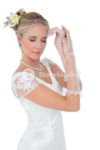 Bride with eyes closed posing over white background