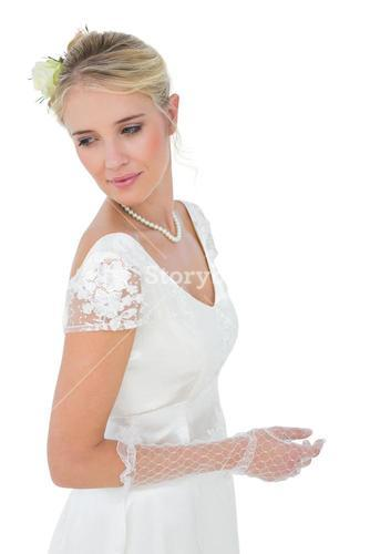 Bride looking over shoulder against white background