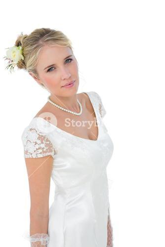 Confident bride standing against white background